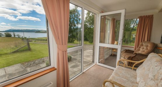 Self-catering cottage looking onto Loch Awe from the comfort of the sun lounge and patio