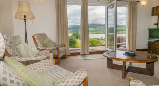 Stable Cottage Lounge looking out to Loch Awe