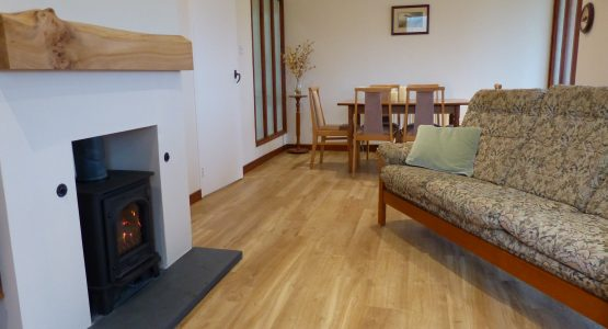 Lounge with cosy gas stove in Barr-beithe Lower holiday cottage