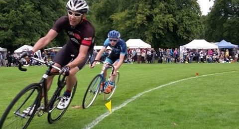 Men cycling round the highland games field in a competion