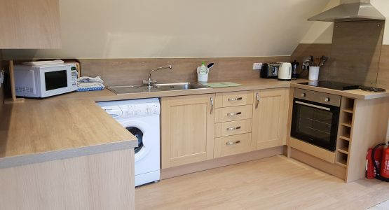 wood effect kitchen with appliances